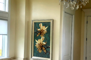 Custom-framed art installed in a bathroom
