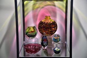 Multicolor glass vases, bowl, paperweights, and perfume bottle