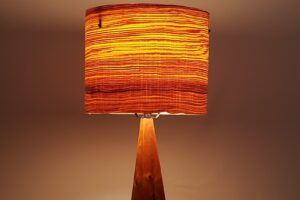 Mike Scribner cherry + curly olive ash wedge lamp, 12 x 12 x 24.5