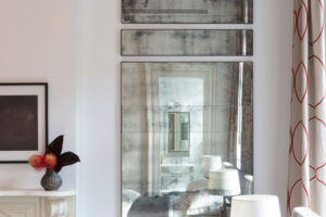 Custom installation of American-made mirror with light distressing
